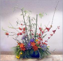 Chinese New Year theme in bamboo, flowering quince ikebana.
