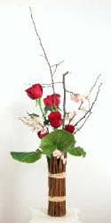 roses in vase wrapped with cinnamon sticks